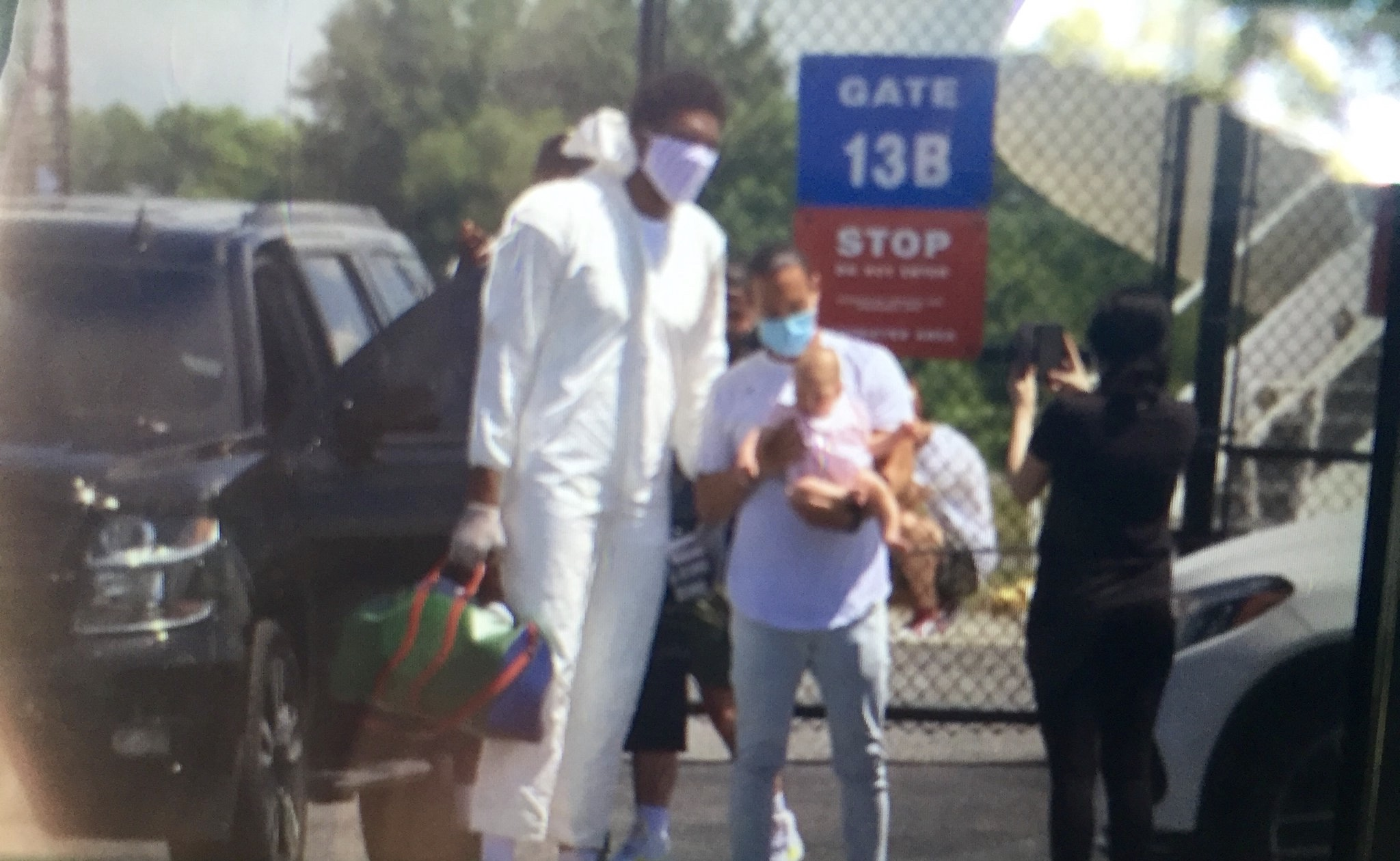 Video: Embiid Puts On A Tyvek Suit Before Flight To Orlando