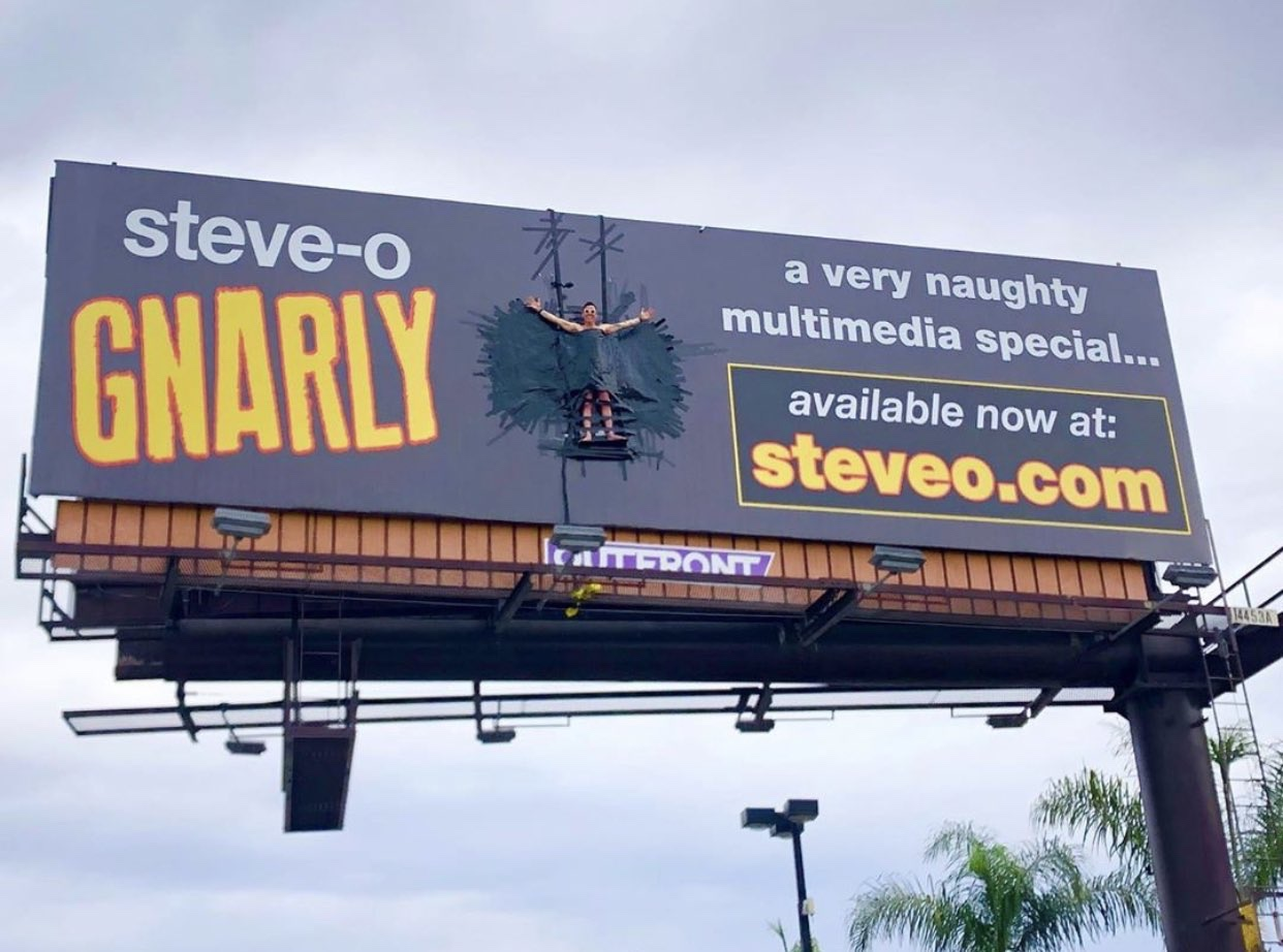 Steve-O Duct Taped Himself To A Billboard